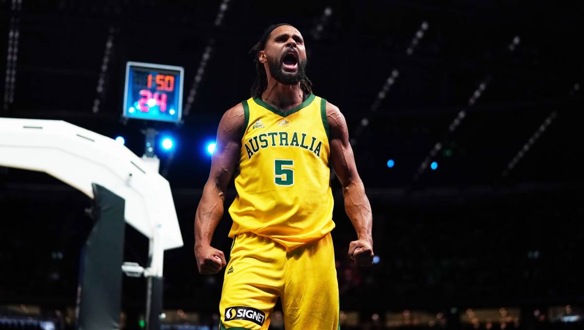 Patty Mills celebrates after Australia's win over Team USA