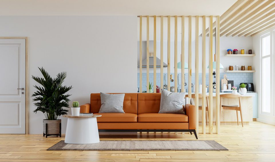 Living room interior wall mockup in warm tones with leather sofa which is behind the kitchen.