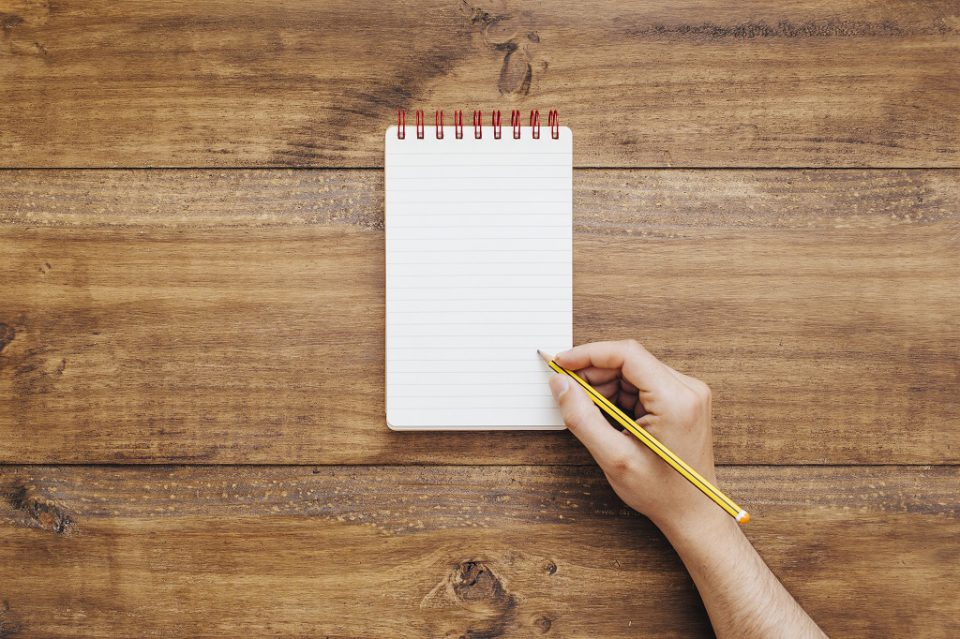 Hand writing on small notepad